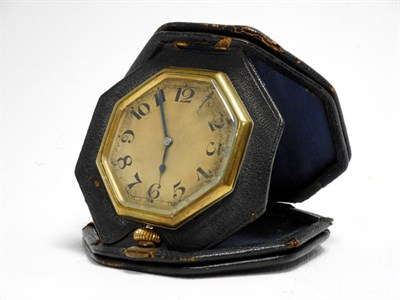 Lot 55 - A Black Leather-Cased Octagonal Travelling Time Clock