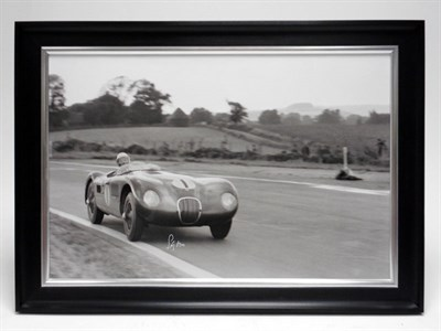 Lot 148-Stirling Moss in the Jaguar C-type (Signed)