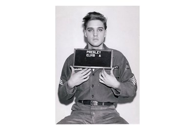 Lot 95-Elvis Presley's Army Mug Shot, 1960