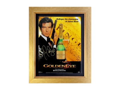 Lot 9 - Pierce Brosnan as James Bond 'Goldeneye' Bollinger Advertising Showcard (Signed)