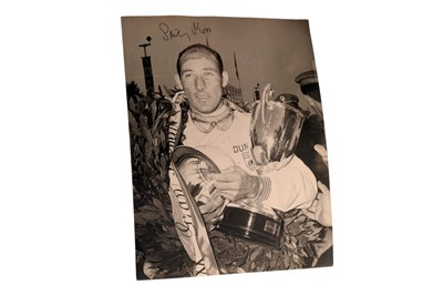 Lot 85-Stirling Moss Signed Period Press Photograph