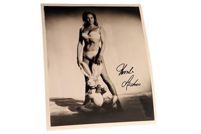 Lot 89-James Bond / Ursula Andress Signed Dr No Press Photograph