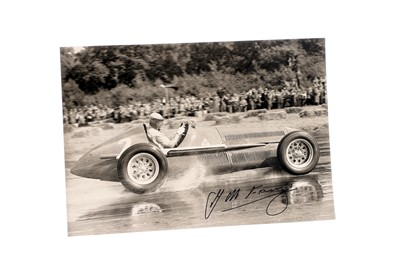 Lot 95-Juan Manuel Fangio Signed Period Photograph