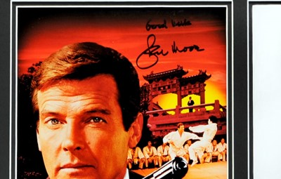 Lot 83 - Roger Moore as James Bond - 'The Man With The Golden Gun' Signed Press Photograph / Poster Presentation
