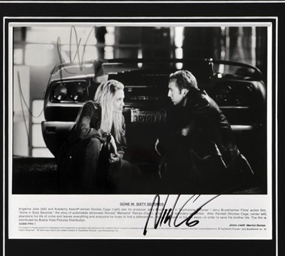 Lot 92 - Nicolas Cage and Angelina Jolie 'Gone in Sixty Seconds' Signed Publicity Photograph Presentation