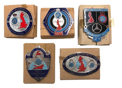 Lot 137 - Five Boxed RAC International Rally Competitor Badges