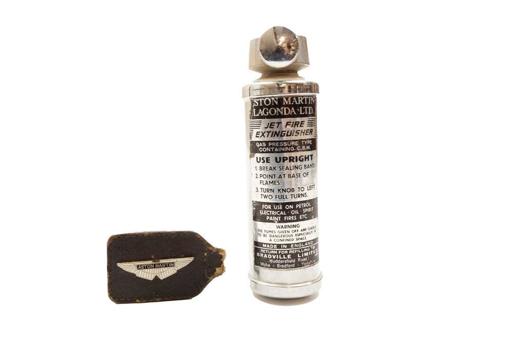 Lot 45 - Aston Martin Fire Extinguisher and Key Fob