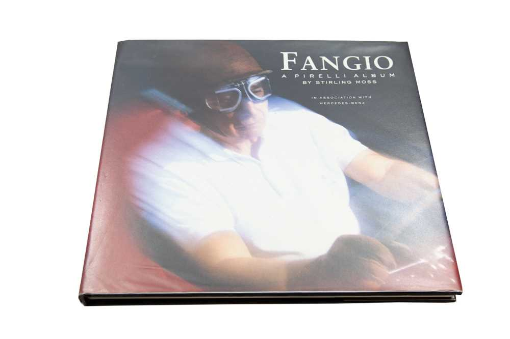 Lot 78 - 'Fangio - A Pirelli Album' - Signed by Juan-Manuel Fangio and Stirling Moss
