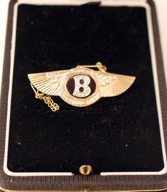 Lot 215-Diamond Encrusted Golden Bentley Brooch