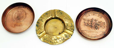 Lot 216-Copper Daimler Ashtrays