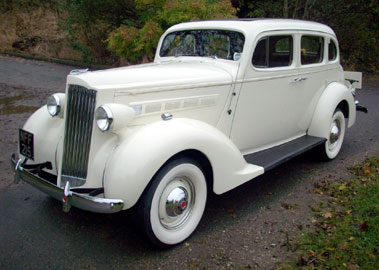 Lot 30-1937 Packard Six 115C Touring Sedan