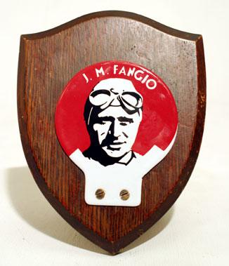 Lot 214-J.M. Fangio Enamel Motorcar Badge