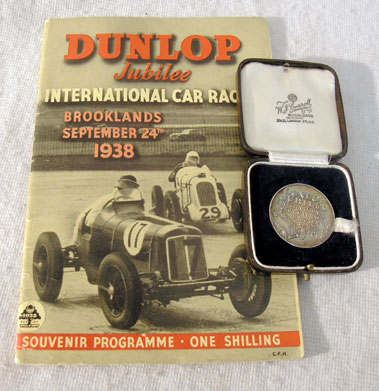 Lot 126-1938 Dunlop Jubilee International Trophy Programme / Medallion