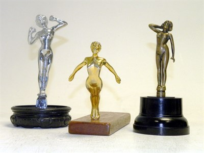 Lot 320-Three Nude Female Mascots