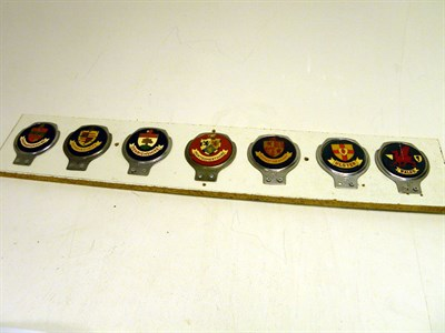 Lot 323-Seven Motorcar Badges