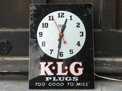 Lot 76 - A KLG Plugs Wall Clock
