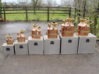 Lot 88-Set of Six Copper Petrol Measures (R)