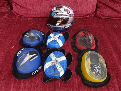 Lot 9-Signed Knee Sliders