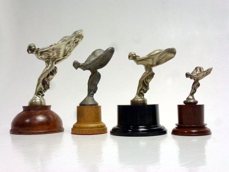 Lot 27-Four Rolls-Royce Spirit of Ecstasy Mascots