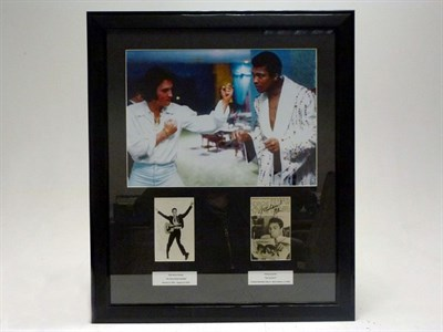 Lot 10-Elvis Presley and Mohammed Ali Signed Presentation