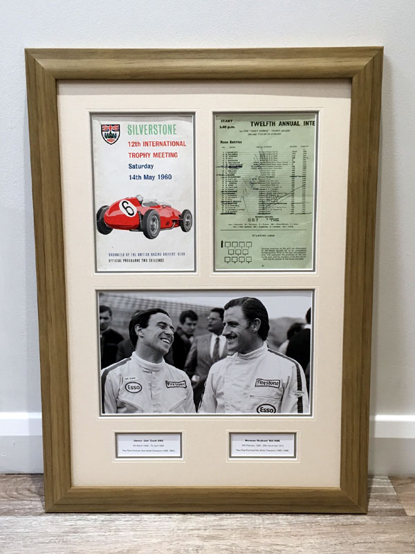 Lot 40-Jim Clark / Graham Hill Signed Presentation