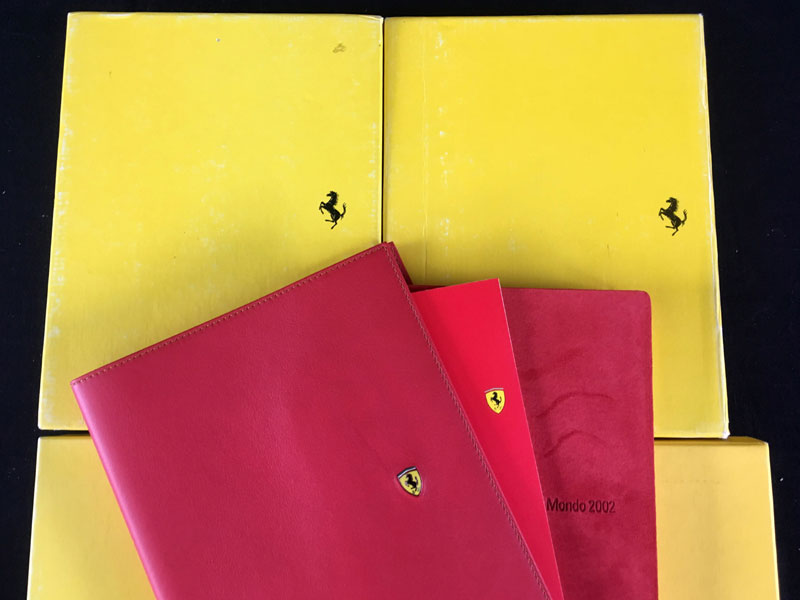 Lot 62-Boxed set of Four Ferrari 'Cliente' Leather Agendas