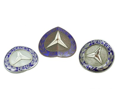 Lot 63-Three Mercedes-Benz Badges